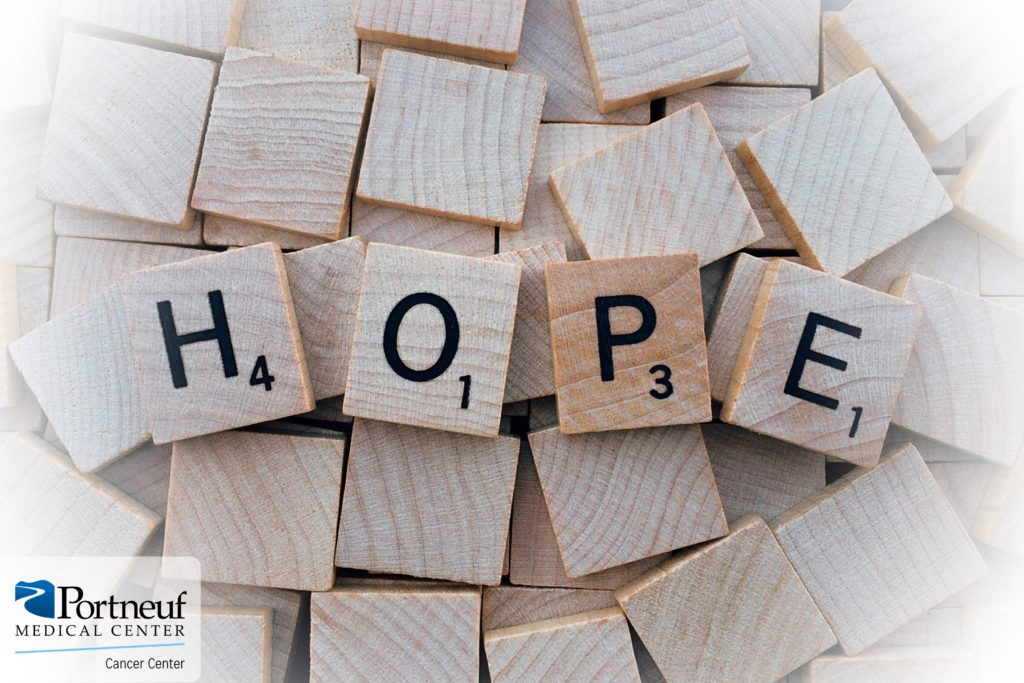 HoPe spelled out in scrabble letters with Portneuf Cancer Center logo