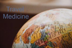glove with the words travel medicine in the upper left hand corner. It is a graphic to help draw people to read the article
