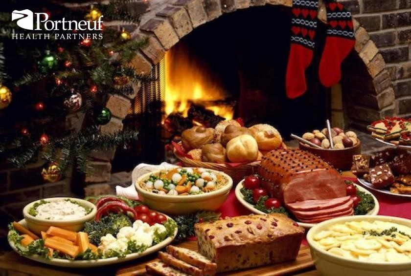 a buffet of holiday foods sitting next to a warm fireplace