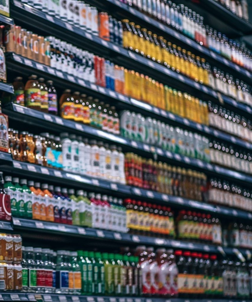 a wall of drinks at a grocery store