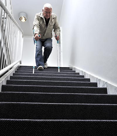 elderly man on precarious steps